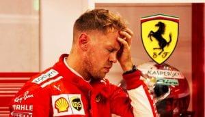 Sebastian Vettel con la mano en la frente