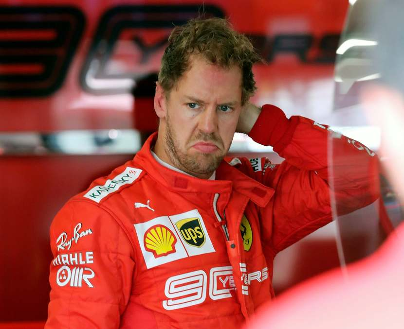 Sebastian Vettel vestido de Ferrari